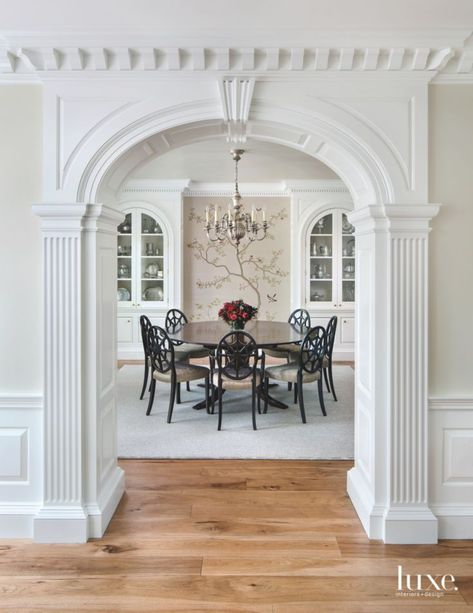 Traditional White Ornate Arch Entrance To Formal Dining Room With