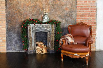 Christmas Decorated Interior With Fireplace Holiday Decorations In A Room New Year Mood Leather Chair Near Fireplace Leather Chair Decor Interior Decorating