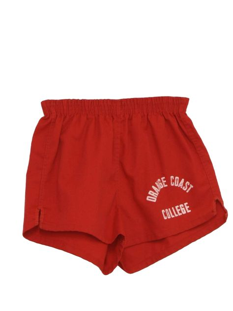70's Collegiate Shorts: 70s -Collegiate-Pacific- Unisex red cotton blend twill with off-white -Orange Coast College- screen printed on one leg, elastic waist sport shorts with notched side vents, double seams, marked 28 to 30 waist but measure 21 to 28waist