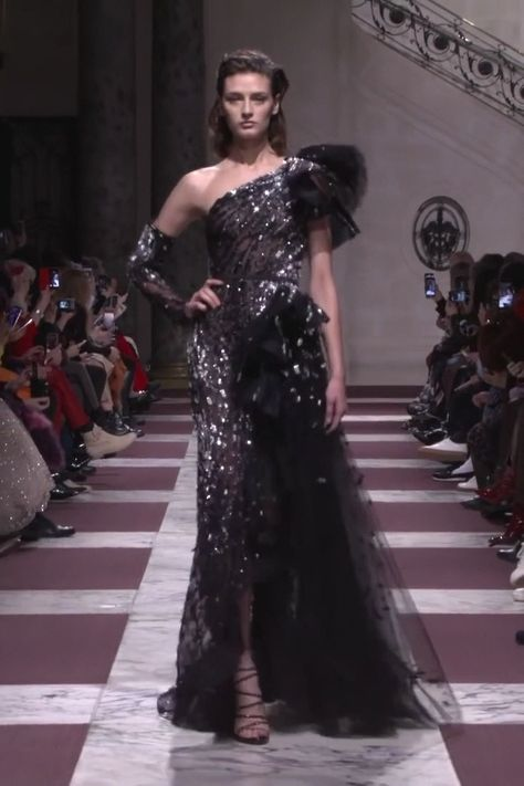 Stunning Embroidered Black One Shoulder Slit Mermaid Evening Dress / Evening Gown with One Detachable Long Sleeve and a Train. Spring Summer 2019 Haute Couture Collection. Fashion Runway by Ziad Nakad #longsleevecocktaildresses