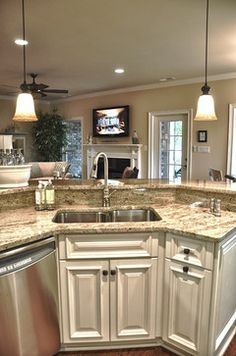 raised bar behind the sink love this i have this already but like the kitchen cabinets