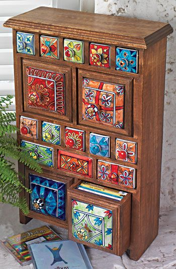 DIY This could be done with an old chest of drawers. Buy various size tiles (glue on) and drawer pulls, make them look like a lot of smaller drawers. Or paint your own pieces of wood and plain wood pulls to use.