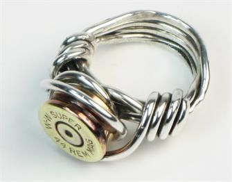 Custom Bullet Shell Ring: cut the end off of the bullet shell, drill a hole in the side and then wrap sterling silver wire around the shell. Guys really go for this ring. It's chunky and comfortable.