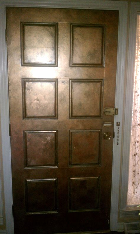 Ordinary wood door faux painted to look like copper.