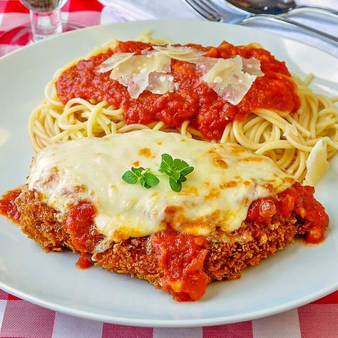 This quick and easy recipe for 30 Minute Chicken Parmesan has been a supper standard in our family for many, many, years and is still my kid's absolute favourite no fuss dinner. There's no easier way to get Noah home on time for dinner than to tell him that this chicken and pasta is on the menu. My mom first started making her version of this recipe longer ago than I can remember. #chickendinner #quickandeasymeals #mealprep #menuplanning #mealplanning