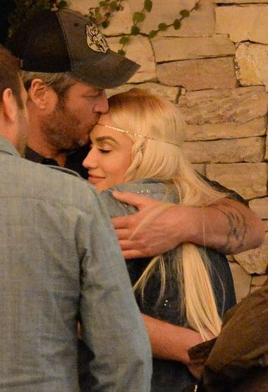 Gwen Stefani and Blake Shelton shared a sweet kiss and laughs while