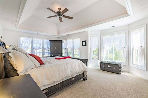 Master Bedroom With Dark Wood Furniture And Bed Frame Tan