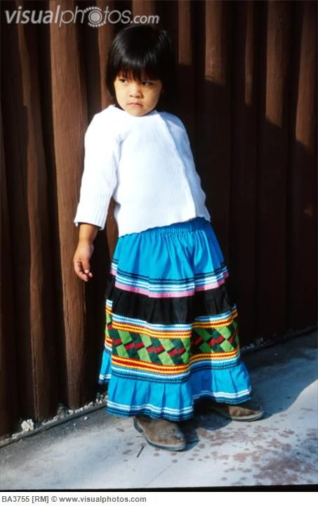 Seminole girl. (Native american girl from the Seminole tribe, wearing a patchwork skirt at the arts festival on the Miccosukee Indian Reservation. (Florida Everglades).)