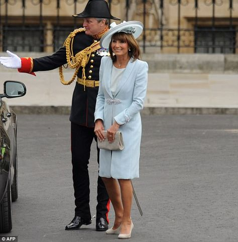 803739e44e Royal mother of the bride  Carole Middleton arrives at Westminster Abbey  looking stunning in a blue Catherine Walker dress