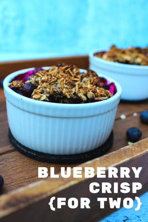 Want a healthier dessert? This Gluten-Free Blueberry Crisp is it. Just a handful of ingredients and lots of fresh blueberries, this is one summer dessert you don't have to feel guilty about. And it makes just two servings! #dessertfortwo #recipesfortwo #glutenfree