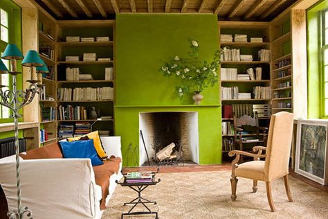 """Color Watch: An Idea on how to use Chartreuse!"" -- ""I think this living room with a chartreuse painted fireplace and the chartreuse trimmed windows [and the back of the bookcases surrounding the fireplace] shows how a little chartreuse can go a long way to make a design impact!"""