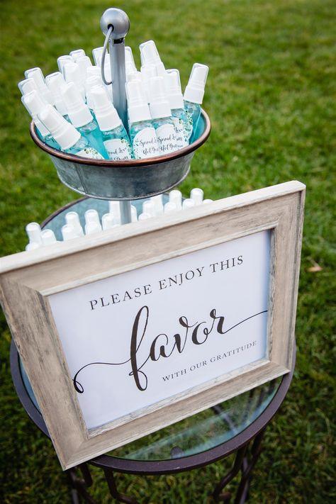 Hand sanitzer as a wedding favor for a COVID wedding | Photographer: Eric Talerico #weddingfavorideas #weddingfavors #njweddingvenue #covidwedding #covidweddingideas #rockislandlakeclub
