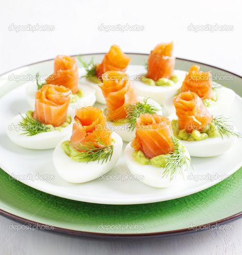 Download - Stuffed eggs. Hard boiled eggs with avocado filling and smoked salmon — Stock Image #45055253