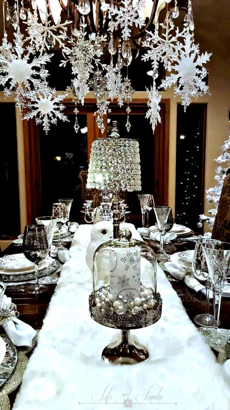 Easy DIY hanging snowflake winter decor idea using dollar store snowflakes and ribbon. This would be elegant as a Christmas decoration or at a winter wedding. A lot of great budget decor ideas for the home, winter wedding, or Christmas party. #ChristmasDecorationIdeas #Christmas #wedding #ChristmasParty #christmas decor diy hanging