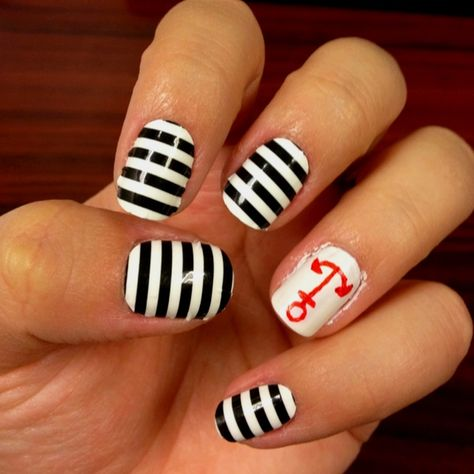 Nautical nails for the 4th of July! I used Nail Rock designer nail wraps on most of my nails, painted my ring finger with white nail polish, and drew an anchor with a red Sharpie! #nails