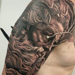 Black And Gray Realism Tattoo Of Zeus With Lightning Coming From The Eyes On The Right Arm Zeus Tattoo Greek Tattoos Tattoos