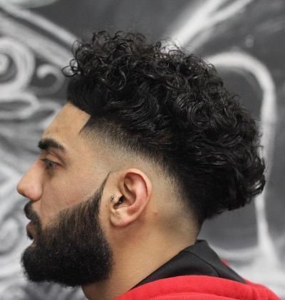 Short Fades And Medium Curly Hairstyle Curly Hair Men Curly Hair Styles Men S Curly Hairstyles