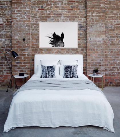 brick wall in bedroom. love the horse print