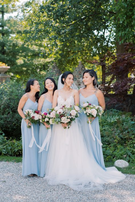 Blush, dusty rose, and raspberry red floral designs by @flower597toronto accentuated the couple's blue-forward palette -- don't miss all the pretty details in the full gallery on stylemepretty.com, captured lovingly by @whitneyheard! 🍃 #stylemepretty #bridesmaids #bridesmaidphoto #bluebridesmaiddress