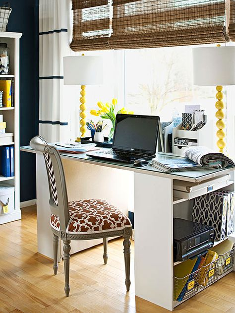 Create a DIY desk with two bookshelves for enviable storage space: http://www.bhg.com/rooms/living-room/family/declutter-your-living-room/?socsrc=bhgpin020415diydesk&page=7