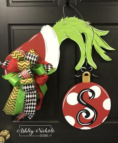 Our whimsical Grinch hand is a fun piece and is adorned with a nice streamer bow!! It would also look great paired with our Grinch wreath or our Grinch flag! Order it plain or with your initial painted on it!**If you choose an INITIAL, list the initial wanted in the CUSTOM TEXT SECTION ABOVE.**Bow patterns and colors s