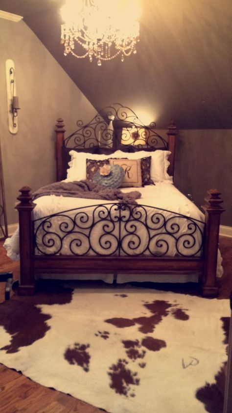 Classy southern bedroom with a cowhide rug!