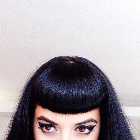 Why can't my Bettie Bangs lay so perfectly? I've been thinking about going black, and this is just swaying me even more...