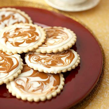 Showstopping Christmas Cookie Recipes -- Two-Tone Glazed Cinnamon Cookies                                    A soft cream-cheese based sugar cookie gets the royal treatment with decadent swirls of easy homemade glazes