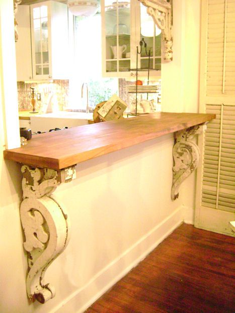 A trip to a salvage store for brackets & to Lowe's for wood shelf.....a nice looking, heavy piece to fill a large space at a fraction of the cost of a countertop.