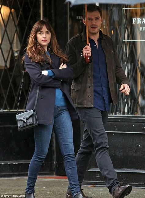 You can stand under my umbrella: Jamie happily held a large umbrella over his co-star...