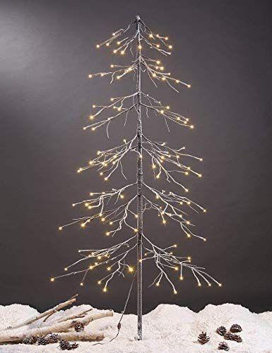 5 Modern Christmas Trees For Less Than 100 This Minimal House Outdoor Christmas Tree Snowy Christmas Tree Christmas Tree Lighting