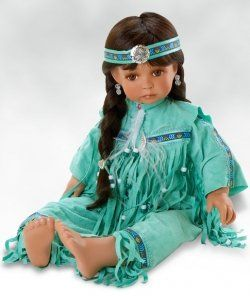 Spirit Child   Details abound in this beautiful Native American doll. She is costumed in a rich turquoise outfit trimmed in traditional Native American colors. Her dark black hair is perfectly set off with her feather headpiece. Spirit Child is approximately 23 inches and comes with accessories shown, a numbered Certificate of Authenticity and a collector's box.       Spirit Child