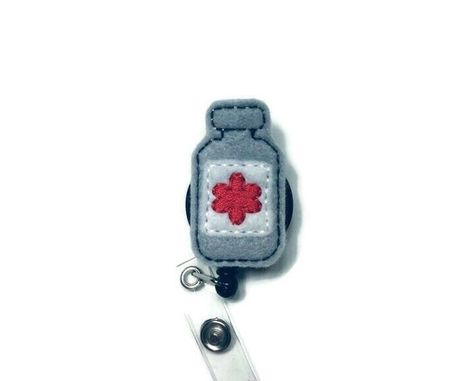 ~This is a listing for a Medicine Bottle Badge Reel, Retractable Reel, ID Badge Holder, Work Badge Holder, Feltie Badge Reel, Lanyard Reel, Nurse Badge Reel, Medical ~These are perfect badge holders and we are starting to offer a variety to choose from. ~We attach feltie to a retractable alligator swivel clip badge reel or slide clip. Refer to the drop down for options. ~As of right now all reels we carry come in black. ~Check out the rest of our badge reels. We are adding more daily.
