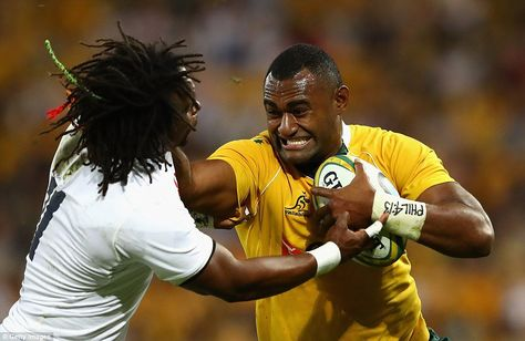 Australia's Tevita Kuridrani (right) fends off a challenge from Yarde during the first Test at Suncorp Stadium