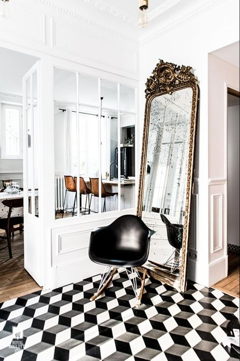 Geometric tiles, antique mirror and RAR chair in the hallway of a fabulous home in Fontainebleau, France. Royal Roulotte.