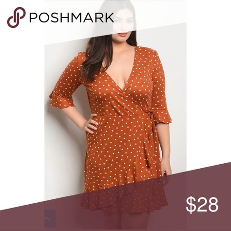Rust Faux-Wrap Dress This rust dress has white polka dots, and its styled like a wrap dress but is sewn shut. It has a tie at the waist that is permanent and does not come untied. 3/4 length ruffle sleeves, and a ruffle hem on the bottom of the dress. Dress runs 1 size small.   material: 95% polyester and 5% spandex Dresses