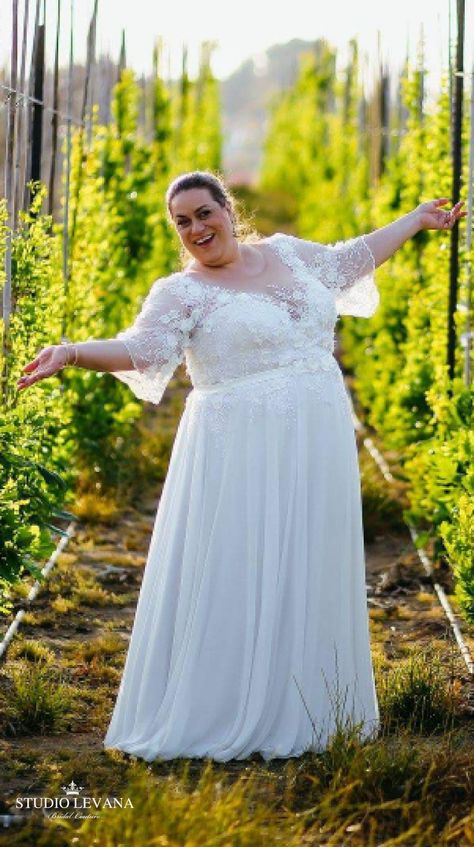 db09233a841 Plus size wedding gown with chiffon skirt and lace sleeves on a real curvy  bride from Studio Levana