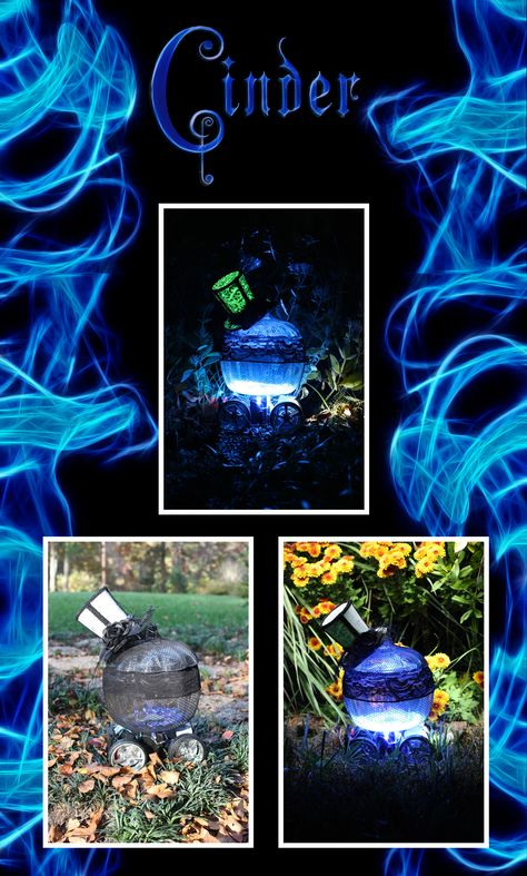 """By Izamar Barrera: """"This pumpkin is made out of glass and I decorated it to make it look edgy and punk-ish. The blue glow makes it look futuristic while it also gives it an eerie Halloween vibe. The wheels and the frame on the bottom make it look as if this really is Cinder's futuristic pumpkin turned """"car""""-riage  and she is going to speed away any second!    If you would like to see more- please see these individual pictures on the board."""""""