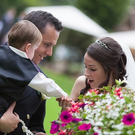 The little page boy gives his Mum (The Bride) a small flower while the Groom looks on. www.headoverheelsphotography.co.uk