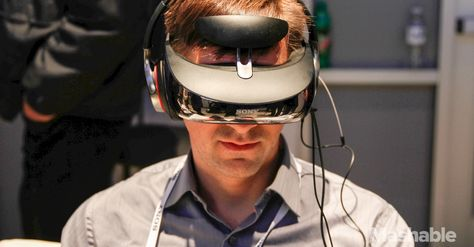 Sony may move into the market dominated by the Oculus Rift and other virtual-reality headsets with an upgrade to its head-mounted display. With a prototype head tracker attached, the visor-like entertainment device becomes an immersive game environment.