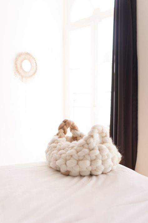 Your cat or small dog will love this warm and cozy 100% natural merino wool chunky knit round bed as much as you love the way that it looks in your home.