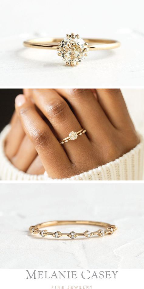 The Unveiled Ring, 0.7ct. Champagne Antique Cut Diamond, is a lovely engagement ring set in 14k yellow gold. Pair it with the Petite Diamond Distance Band for a dainty wedding ring set! These pieces can be found at melaniecasey.com. #engagementring #weddingband #weddingset #antiquediamond #yellowgold