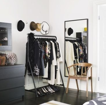 Add a clothes rack to the corner of your room to instantly increase your closet space.