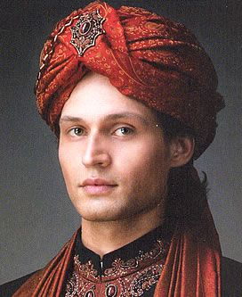 Simply elegant red turban with embellished motif on front which adds beauty to it.  $179.95