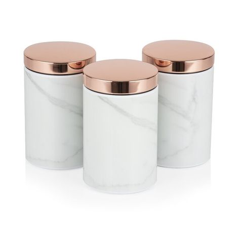 Prolong the freshness of your sugar, tea, coffee, herbs or spices with the elegant 3 Piece Kitchen Canister Set. Each canister can hold a capacity of up to 1.4 litres, allowing you to store larger quantities of each ingredient. The stainless steel construction comes coated with a beautiful white marble finish and rose gold plated lids that add for a beautiful addition to the kitchen counter. Require only a simple wipe down to maintain their eye-catching appearance.
