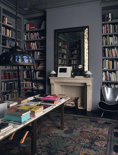 """The library in Reed Krakoff's Manhattan townhouse."" -- Click through for ""A Peek Inside The Homes Of 11 Famous Fashion Designers"" -- Love the gray walls and shelves, the mirror ... pretty much all of it!"