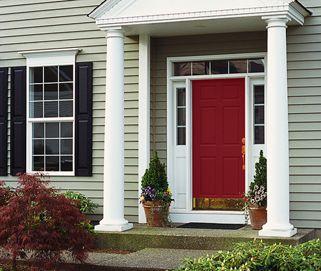 Tan house green roof red door pictures
