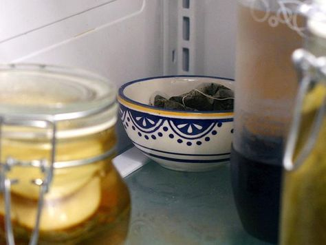 Brewed tea can be used to clean windows, mirrors and countertops. Spray on your bathroom surfaces just as you would any typical window or surface cleaner. Then, keep your bags to hide in the back of the fridge. They will actually work to deodorize it!