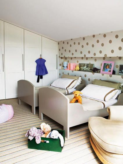 kids room with gold polka dot wall.