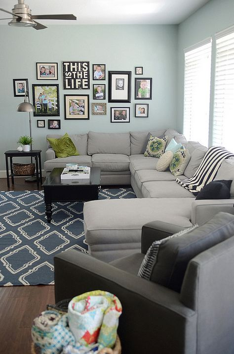 Aqua, taupe, black and white. This living is a perfect fit for family living with it's sectional sofa and black accent tables.
